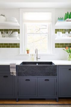 Cutest Kitchen Remodel   Navy blue cabinets soapstone sink