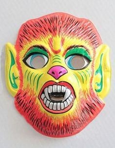 hairy monster with fangs - vintage retro plastic Halloween mask