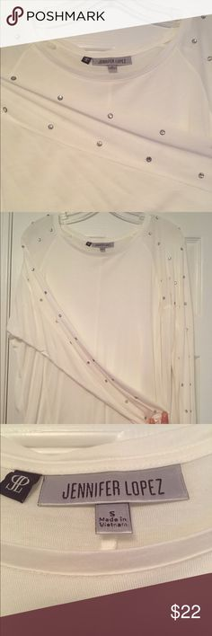 """🎾Jennifer Lopez Dressy Shirt w/Rhinestones This is a dressy top with rhinestones that start at the top of the shoulders and run down the sleeve- Size Small. It's a little sheer. The back is longer than the front (see measurements). Perfect for leggings or even jeans. Excellent condition, was only worn once. Ⓜ️: Front: 21""""; Ⓜ️: Back: 28"""". Jennifer Lopez Tops Tunics"""