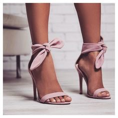 ribbon and bow heels in a light pink colour