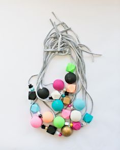DIY T-Shirt Yarn Beaded Necklaces. Our kids had so much fun making these bright and colorful necklaces!