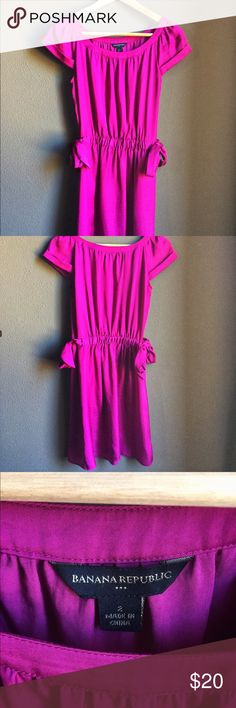 Banana Republic Size 2 short sleeve dress Pre owned in excellent condition! Fushia color (pink/purple family) with side ties and discrete pockets! This dress is very flattering and also comfortable to wear! Great spring color! Very slight wear under arms, attached pic. Banana Republic Dresses