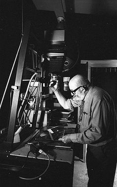 Photographer Ansel Adams makes an adjustment to the exposure while making a print in the darkroom at his home in Carmel, Calif., 1968.