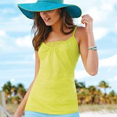 Pack of 4 bright camis in the season's must-have colors (chartreuse, white, fuchsia and black). Features a feminine lace-front detail, adjustable straps and ruching at the neckline. · Cami: 60% Cotton, 40% Polyester Lace: 100% Nylon Wash before wearing. Machine wash cold on gentle cycle with similiar colors; do not use chlorine bleach, use only non-chlorine bleach, if needed. Tumble dry low; remove promptly; cool iron as needed. Imported