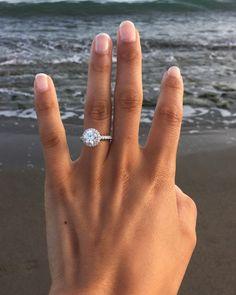 round halo engagement ring