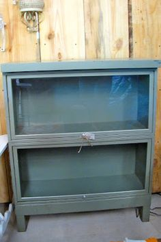Green metal doctor's office shelves with pull down glass fronts!