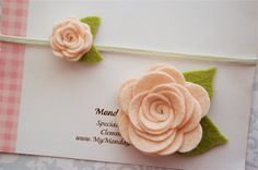 These pretty wool felt roses are so soft and have so many layers! Made of wool blend felt with two wool felt leafs. The Mommy flower measures a little over 2 inches and is attached to an alligator clip. The little rosebud measures 1 inch and is attached to a skinny elastic headband. A soft and pretty accessory and a sweet and thoughtful gift! Perfect for photos and new moms! This item also works well for big sister and little sister! (Also available as a pair of hair clips or a pair of…
