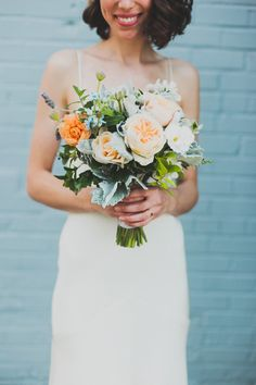 fluffy peach bouquet, photo by Chaz Cruz http://ruffledblog.com/modern-brooklyn-wedding #weddingbouquet #flowers