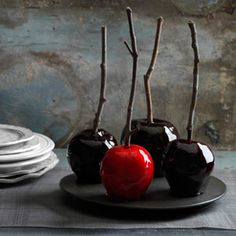 Decadently Dark Candy Apples    The magic ingredients for these bewitching apples? A deep crimson variety like Red Delicious, a few drops of food coloring—plus a dash of spicy cinnamon.    (Skewers: Twigs from your hard work just fine! Use a damp paper towel to wipe clean.)