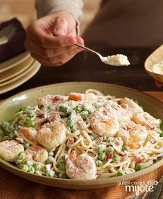 You've heard of Spaghetti Carbonara, but how about Shrimp Carbonara? Spaghetti pasta gets tossed in a creamy sauce with bacon, shrimp, peas and Parmesan in this 20 minute pasta dish. Seafood Carbonara, Shrimp Recipes, Pasta Recipes, Bacon, Spaghetti, What's Cooking, Cooking Recipes, Shrimp Pasta, What To Cook