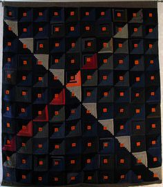 Fabulous wool Log Cabin quilt -- Owner says: All I know is that it came from an estate sale at a ranch in Colorado. It was one of about five or six that had been stored in a trunk for years. They were all log cabin variations made from wool, and all in near mint condition.