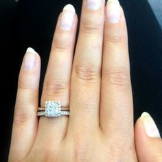 Tacori engagement ring and wedding band.