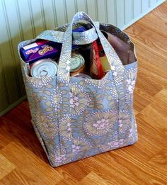 """Pretty AND practical. MATERIALS: You'll need 1 yd. of fabric and matching thread. I used August Fields by Amy Butler. It's a decorator weight fabric in a scrumptious color. NOTE: 1-3/8 yds. of 58""""-60"""" wide fabric will make two bags...."""