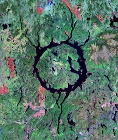 Manicougan Crater, Quebec, Canada. A 100 kilometer diameter crater with central uplift and radiating fractures. NASA Landsat.