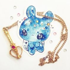 I tried adding gold ink accents to the constellation bunny, but I haven't used it in so long that it dried up ;^; -hence the little splotch on the left ear lol *sailor moon necklace and gems instead*