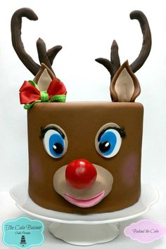 Behind the cake - Cake decorated with fondant as a reindeer cake with molded antlers and red nose cake decorating recipes kuchen kindergeburtstag cakes ideas Christmas Themed Cake, Christmas Cake Designs, Christmas Cake Decorations, Holiday Cakes, Christmas Goodies, Christmas Treats, Christmas Cakes, Xmas Cakes, Cake Decorating Books