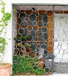 I'm thinking this can be made with slices of pvc pipe and spray painted modern fences, creative fence, creative gate, metal fence, Tor Design, Gate Design, Apartment Front Doors, Gate Pictures, Burglar Bars, Security Gates, Window Security Bars, Security Tips, Window Bars