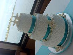 White and aqua starfish wedding cake  Cortney and Ryan ordered one like this!