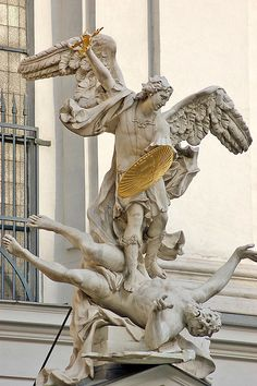 Archangel Michael outside St. Michael's Church in Vienna, Austria. St. Michael's is dedicated to Archangel Michael and the church itself is over 800 years old.