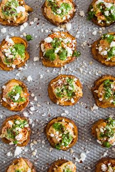 These pesto hummus sweet potato bites are the perfect bite size appetizer. Sumac roasted sweet potato rounds topped with spicy hummus, drizzled with spinach pesto and sprinkled with crumbled feta - how delicious is that!