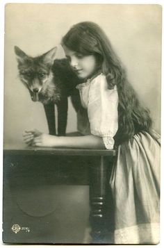 Old photograph of girl with her pet fox . . .no information on date or history . . .:~(