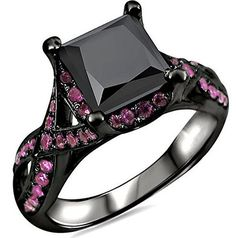 Black Princess Cut Pink Sapphire Diamond Engagement Ring - A unique color combination is is what makes it noteworthy comes this ambiguous Black Princess Cut Pink Sapphire Diamond Engagement Ring stamped in Rhodium Plated 18K Black Gold placed in a Prong setting featuring a Princess cut center stone along with a Round cut Pink Sapphire accent sides stones around the Halo style mount & shank. The Black Princess Cut Pink Sapphire Ring has a total gem weight of 2.50 carats…