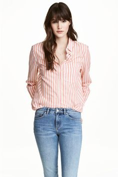Cotton shirt: Straight-cut shirt in airy cotton with a collar, chest pocket and long sleeves with buttoned cuffs.