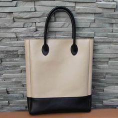 Cream and black satchel.