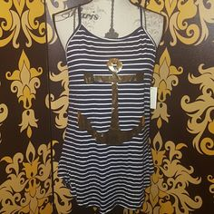 BNWT Metallic gold anchor tank BNWT. The cutest navy blue and white striped tank with a metallic gold anchor print. Tops Tank Tops