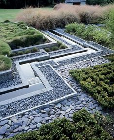 water framed by grey pebbles and geometric planting #landscapedesign