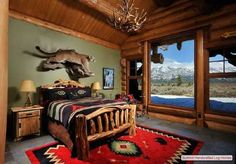 The  focal  point in the bedroom that follows is a magnificent mountain lion mounted on the wall about the headboard of the bed. Also a beautiful Native American rug.