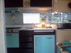 Cool retro contemporary mid century feel. Black and quilted chrome interior accents with original  limed white paneling. 1967 Aristocrat 13' LoLiner. Originally built to fit easily into the garage as an office or extra bedroom when not out with the family camping. Great place to serve your weekend guests martinis. Only $700.00