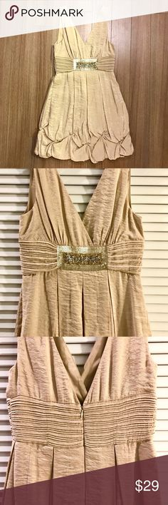 BCBGMAXAZRIA Gold Sleeveless Cocktail Dress NWOT and never worn! Double v-neck, embellished waist, balloon hem dress with pleated details is perfect for any occasion! Comes with extra beading as shown on tag. BCBGMaxAzria Dresses Wedding