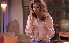 This pink shirt/messy hair combo, which is sexy in a very late '90s Victoria's Secret kind of way.