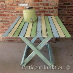 Petticoat junktion's beach table makeover - i would love this in the back yard!