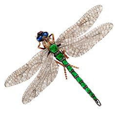 Rare French dragonfly pin attributed to Fouquet. The wings in platinum set with diamonds, the body set with emeralds, and the eyes with two cabochon sapphires, circa 1885.