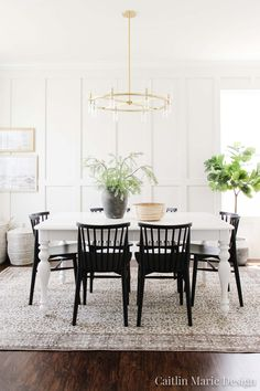 Come see the before and after of our coastal dining room makeover! A few simple updates take this space from builder grade to high end style.   black dining chairs, beige vintage rug, board and batten accent wall, DIY stone vase, wall baskets, white farmhouse table Besta Hack, Fall Entryway Decor, Coastal Master Bedroom, Black Dining Chairs, Inviting Home, Affordable Home Decor, Spring Home, Dream Decor, Modern Coastal