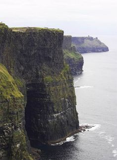 cliffs of moher. See people on top of cliff.