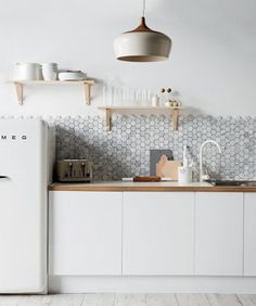 Jackie Brown // Real Living Kitchen // hexagonal mosaic; marble; timber; white Smeg fridge; Coco Flip pendant light; white kitchen mixer tap