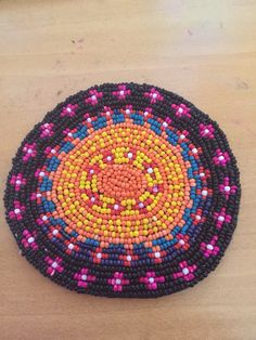 Seed bead coaster Made by me .