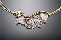 """""""Ray of Light"""" by Aleksandra Vali   Oxidized Sterling Silver, 24k Gold, Garnets, Gold Plated Neck Wire  Photo credit : Aleksandra Vali"""