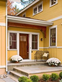 This beautiful wood front door gives guests a warm welcome. More ways to add curb appeal: http://www.bhg.com/home-improvement/exteriors/curb-appeal/ways-to-add-curb-appeal/?socsrc-bhgpin061313tiledoorstep=17