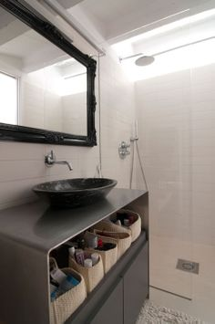 white with black accents, a bathroom easy to maintain and nice to sit in. need.
