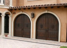 Bringing A Great Presence To This Hacienda Home, These Beautiful Garage  Doors Are Made From Solid Alder Wood And Feature Classic, Spanish Arched  Tops.