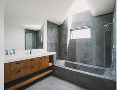 Bathroom : Modern Bathroom Design with Unique Bathtub and Glass Shower Enclosures - Fascinating Bathroom Design Ideas With Concrete Bathtub, Floating Wooden Storage, White Countertop, And Undermount Sink Modern Bathtub, Modern Bathroom Design, Bathroom Interior, Bathroom Designs, Bathtub Designs, Bathtub Ideas, Interior Walls, Bath Shower Combination, Bathtub Shower Combo