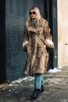 Go for a sophisticated look in a brown fur coat and blue jeans. Finish off your look with black leather lace-up ankle boots.   Shop this look on Lookastic: https://lookastic.com/women/looks/fur-coat-jeans-lace-up-ankle-boots/24134   — White Print Scarf  — Brown Fur Coat  — Black Leather Crossbody Bag  — Blue Jeans  — Black Leather Lace-up Ankle Boots