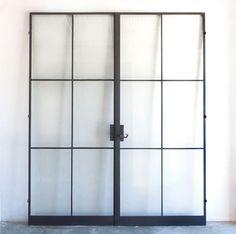 Remodeling Steel Factory-Style Windows and Doors - Remo.- Remodeling Steel Factory-Style Windows and Doors – Remodelista Above: Custom steel frame doors from the Atelier Domingue Architectural Metalcrafts line. Steel Frame Doors, Steel Doors And Windows, Metal Windows, Iron Windows, Iron Doors, Metal Doors, Metal Window Frames, Door Frames, Black Windows