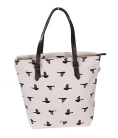 Leather Tote - For those who love new things and their bags are always full of random stuff, this leather tote is a print both inside and out to give you that perfect look. Pick from 4 different patterns to suit your style.