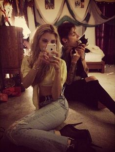 Andy and his cat in the background! Omg this is so cute