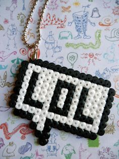 "Kitsch Hama Midi Beads ""LOL"" Necklace, via Etsy."